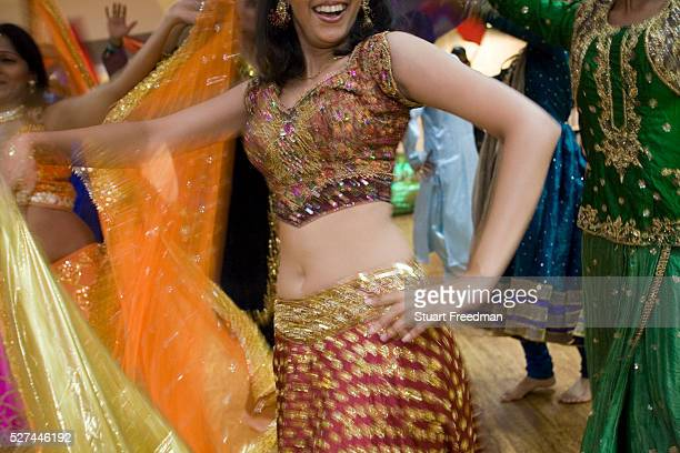Dancer Ashwini Iyer, 23 practices her routine at a rehearsal of the production of The Merchants of Bollywood in a studio in Mumbai, India