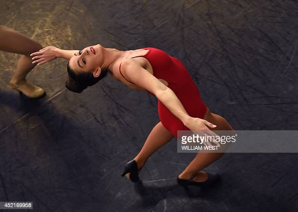 A dancer auditions for the famous Moulin Rouge in Paris which celebrates its 125th birthday this year in Sydney on July 15 2014 The dancers are...