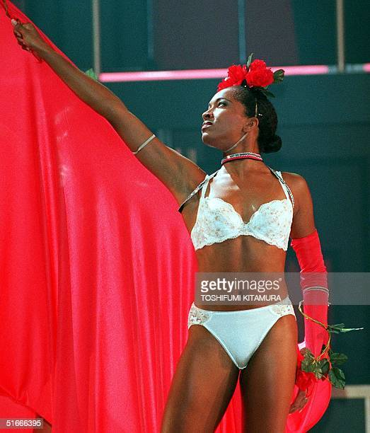 Dancer Celia Grannum performs as she shows off a set of white laced bra and panties during the Forever Tango Triumph '99 Spring and Summer innerwear...
