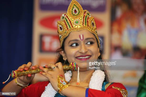 A dancer depicts a pose mimicking Lord Krishna as Bharatnatyam dancers perform an expressive fusion dance mixing classical and modern dance styles...