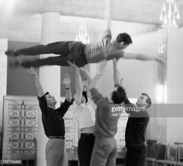 Dancer Dirk Sanders is held aloft during backstage rehearsals for Mary Martin's Easter Sunday live color telecast 1959