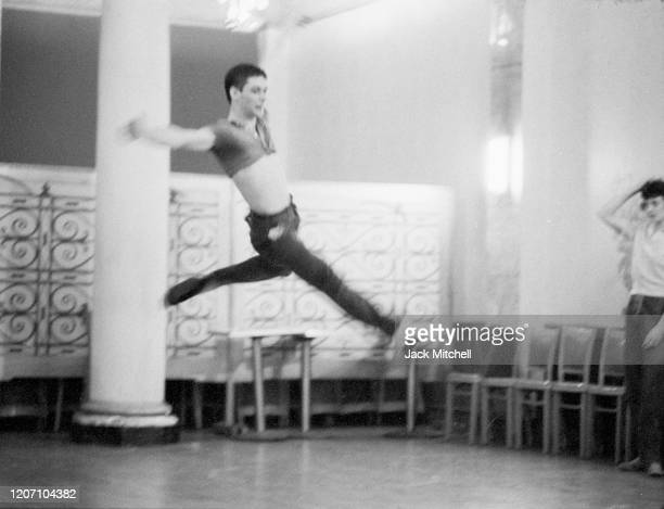 Dancer Dirk Sanders jumps during backstage rehearsals for Mary Martin's Easter Sunday live color telecast 1959