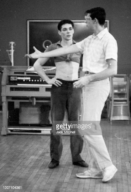 Dancer Dirk Sanders listens to choreographer Joe Layton during backstage rehearsals for Mary Martin's Easter Sunday live color telecast 1959