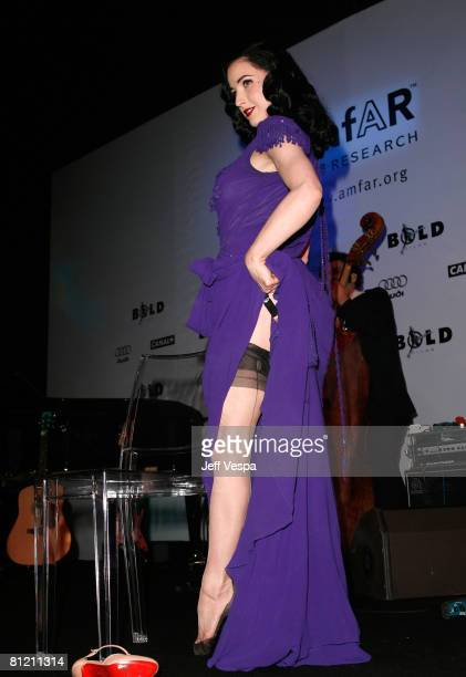 Dancer Dita Von Teese performs during amfAR's Cinema Against AIDS 2008 benefit held at Le Moulin de Mougins during the 61st International Cannes Film...