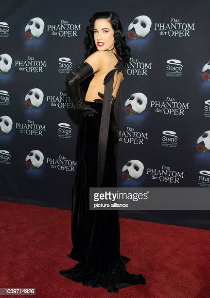Dancer Dita von Teese poses on the red carper outside of the Neue Flora at the premiere of the musical 'Phantom of the Opera' in Hamburg Germany...