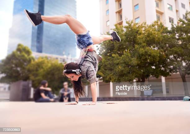 Dancer doing handstand on city square, Cape Town, South Africa