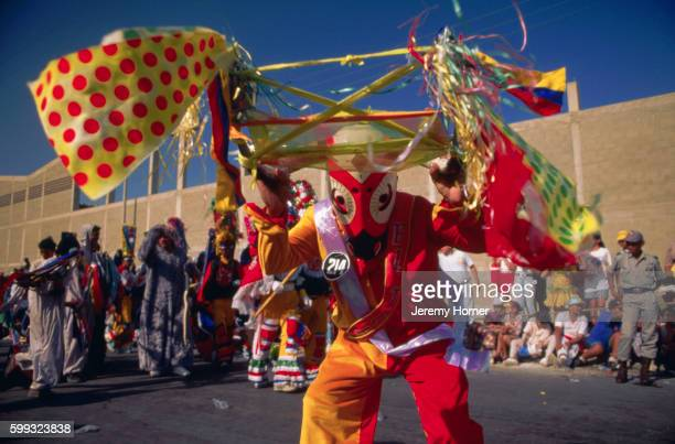 Dancer Dressed as a Creature Participates in a Coloumbian Carnival