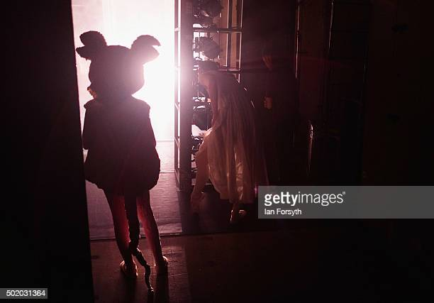 A dancer dressed as a mouse waits in the wings during a performance of The Nutcracker by Northern Ballet at the Grand Theatre on December 18 2015 in...