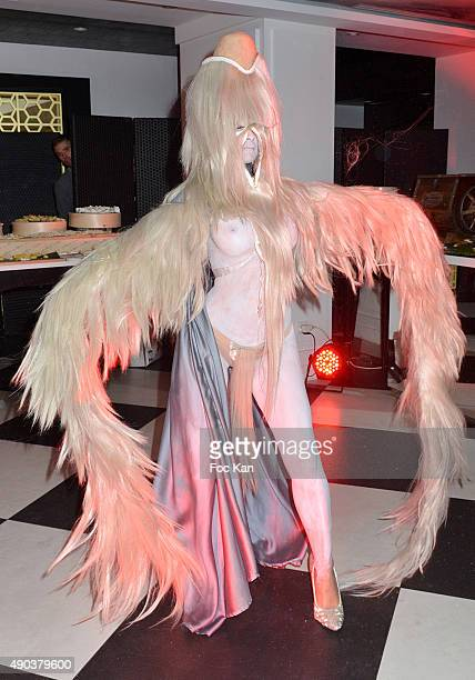 A dancer dressed by Charlie Le Mindu performs during the 'Fromage Fashion Week Menu Day' at Sofitel Stay Hotel on September 27 2015 in Paris France