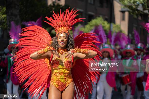 Dancer dressed in a colourful costume during the last day of the Notting Hill carnival. People gather in costumes to present their floats to the...
