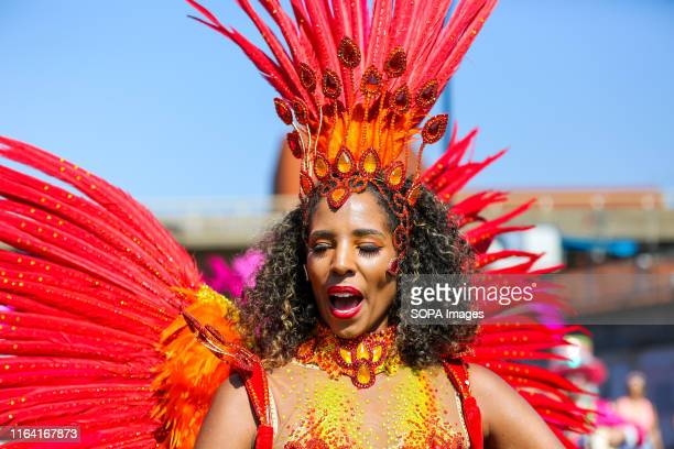 A dancer dressed in a colourful costume during the parade on the second day of the Notting Hill Carnival in west London Thousands of revellers take...