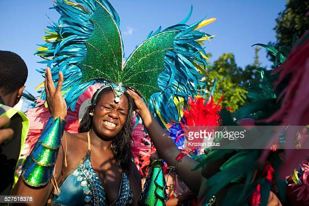 A dancer feels the pinch from her head gear and sqirms in agony The Notting Hill Carnival has been running since 1966 and is every year attended by...