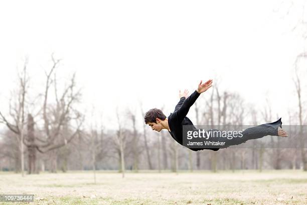 a dancer flies in the park - fliegen stock-fotos und bilder