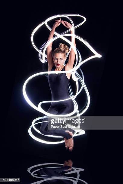 dancer forming an electric spiral around herself