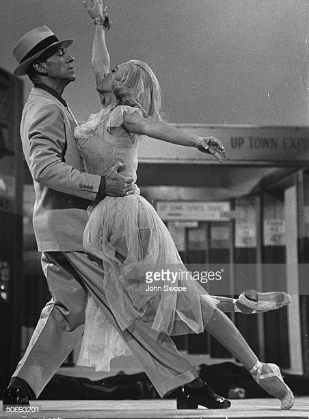 Dancer Fred Astaire dancing w dancer Cyd Charisse in dance number that is a parody of a Mickey Spillane episode in the movie The Band Wagon