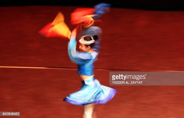A dancer from China's Inner Mongolia Art Troupe performs at the Abdulhusain Abdulredha theatre in Kuwait City on February 19 2017 / AFP / Yasser...