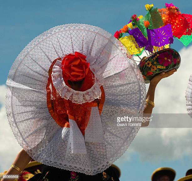 A dancer from Ixtepec city performs during the Guelaguetza celebration on July 27 2009 in Oaxaca Mexico The Guelaguetza is a festival held once a...