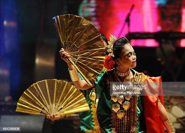 A dancer from Makassar performs a traditional dance during The 10th Cross Culture Festival on August 28 2014 in Surabaya Indonesia The 10th Cross...