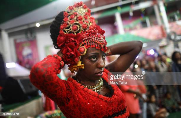 A dancer from PodeC Show waits to perform during a traditional Festas Juninas party at the Mangueira samba school located in the Mangueira favela...