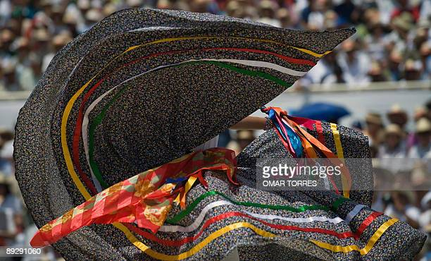 A dancer from San Pedro Ayutla performs during the Guelaguetza celebration on July 27 2009 in Oaxaca Mexico The Guelaguetza is a festival held once a...