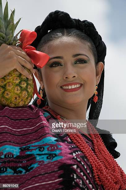 A dancer from Santa Maria Asuncion Tlaxiaco performs during the Guelaguetza celebration on July 27 2009 in Oaxaca Mexico The Guelaguetza is a...