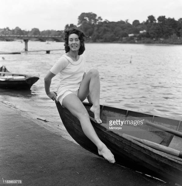Dancer Gillian Lynne has her own idea of a sitting position whilst taking the sun at the Lido Hyde Park in between rehearsals for the musical play...