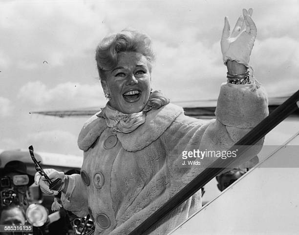 Dancer Ginger Rogers waving as she arrives in the country to star in the BBC production of 'Carissima' at London Airport May 4th 1959