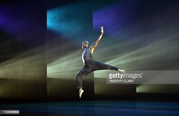 Dancer Glenn Allen Sims of the Alvin Ailey American Dance Theater performs part of 'Four Corners' during a dress rehearsal June 12 2013 as the Alvin...