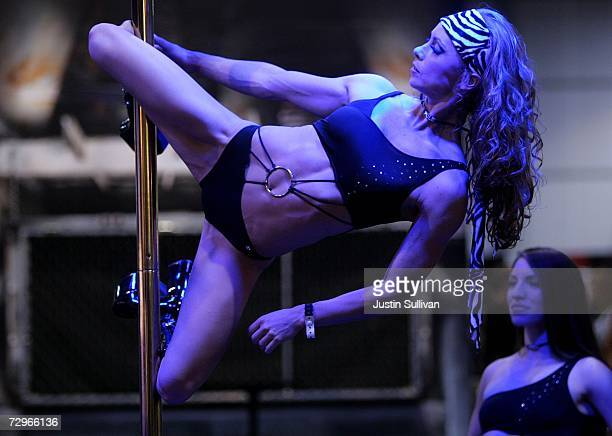 A dancer hangs from a pole as she performs at the 2007 AVN Adult Entertainment Expo at the Sands Convention Center January 10 2007 in Las Vegas...