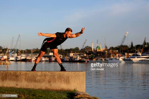 Dancer Heath Keating is seen recording a dance/fitness routine on the shoreline at Blackwattle Bay on April 21, 2020 in Sydney, Australia. Prime...