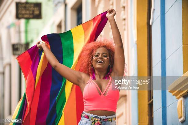 dancer holding an lgbt flag - gay rights stock pictures, royalty-free photos & images