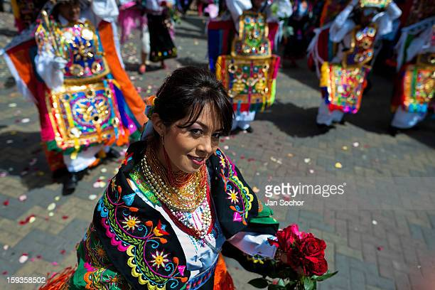 A dancer holding flowers performs in the religious parade within the Corpus Christi festival in Pujilí Ecuador 10 June 2012 Every year in June...
