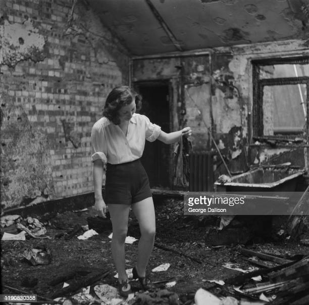 A dancer in a bombed out dressing room works on a revue by choreographer Buddy Bradley in the UK during World War II October 1940