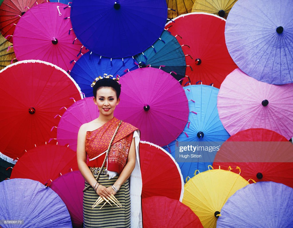 Dancer in Front of Parasols : Stock Photo
