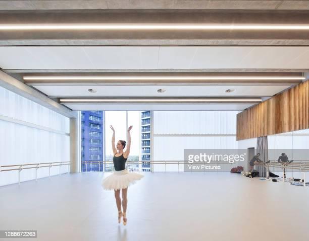 Dancer in rehearsal studio. English National Ballet, London, United Kingdom. Architect: Glenn Howells Architects, 2019.