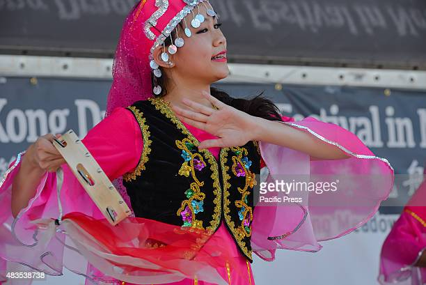 A dancer in traditional costume performs on the festival's main stage The twoday 25th Annual Hong Kong Dragon Boat Festival was held in Flushing...