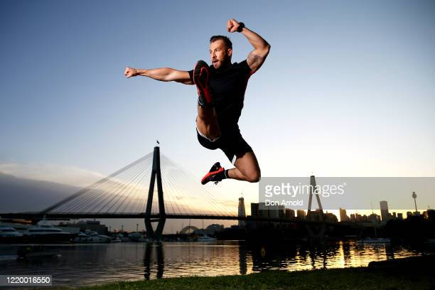 Dancer instructor and musical theatre performer Heath Keating performs a dance manoeuvre on the shoreline at Blackwattle Bay on April 21 2020 in...