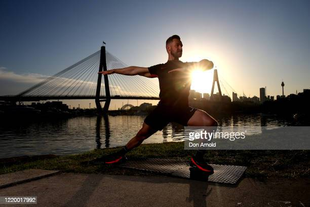 Dancer, instructor and musical theatre performer Heath Keating performs a dance manoeuvre on the shoreline at Blackwattle Bay on April 21, 2020 in...