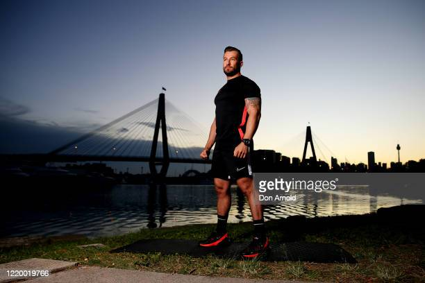 Dancer instructor and musical theatre performer Heath Keating poses on the shoreline at Blackwattle Bay on April 21 2020 in Sydney Australia With...