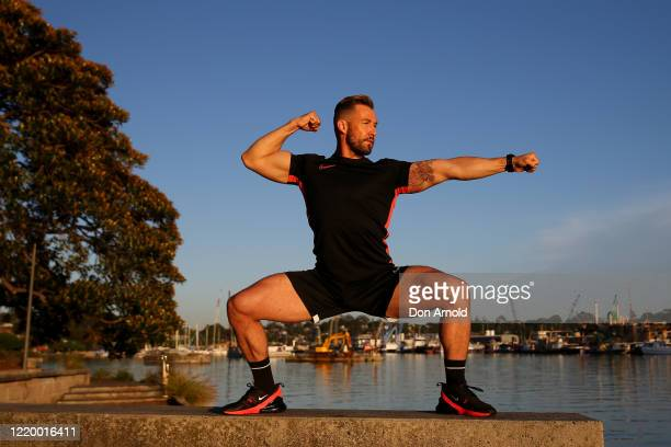 Dancer instructor and musical theatre performer Heath Keating records a dance/fitness routine for his social media followers on the shoreline at...