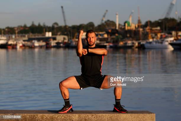 Dancer, instructor and musical theatre performer Heath Keating records a dance/fitness routine for his social media followers on the shoreline at...