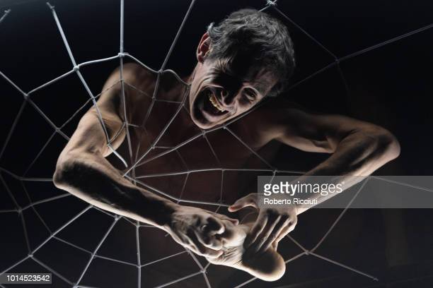 Dancer Ismael Oiartzabal of Philippe Saire Company performs 'Hocus Pocus' on stage during a photocall at The Studio for the Edinburgh International...