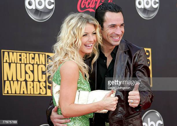 Dancer Julianne Hough and her Dancing with the Stars partner indie race car driver Helio Castroneves arrive at the 2007 American Music Awards held at...