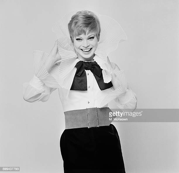 Dancer Juliet Prowse modelling a white pleated organza blouse and black velvet skirt by Roma Roberts UK 27th October 1967