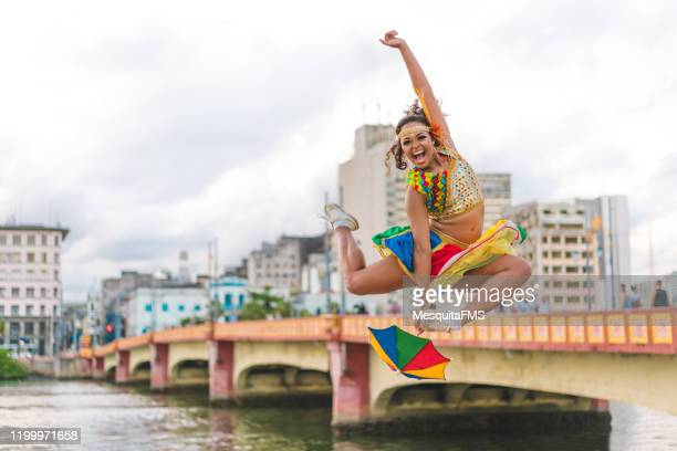 dancer jumping and enjoying the carnival - frevo imagens e fotografias de stock