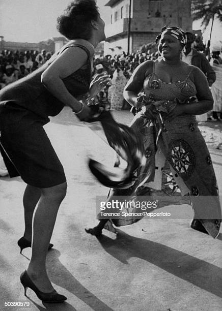 Dancer Katherine Dunham gathering up new dancers during her talent scout through Africa