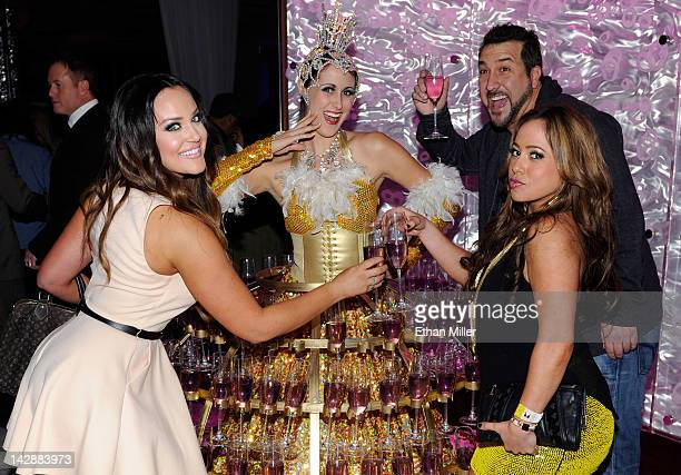 Dancer Lacey Schwimmer entertainer Joey Fatone and singer/actress Sabrina Bryan pose with a model serving drinks at the after party for the grand...