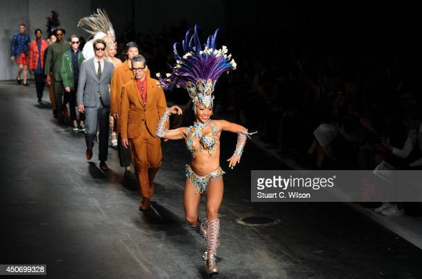 A dancer leads models down the runway at the Oliver Spencer show during the London Collections Men SS15 on June 16 2014 in London England