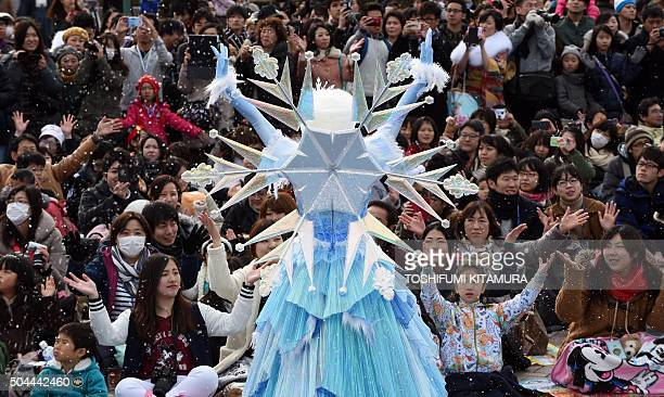 A dancer leads spectators during the Frozen Fantasy parade at Tokyo Disneyland in Urayasu eastern suburb of Tokyo on January 11 2016 TDL started its...