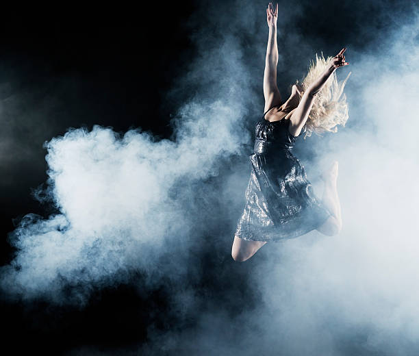Dancer leaping through smoke